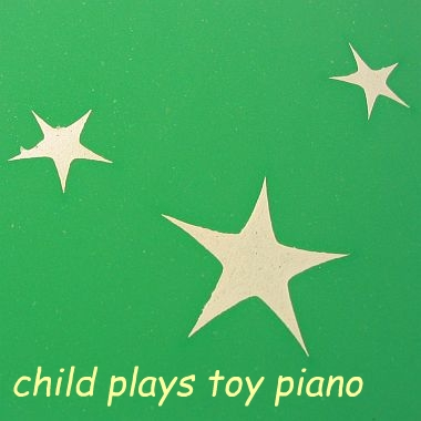 Child Playing With Toy Piano - 1